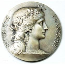 Médaille argent des beaux arts, décernée en 1937 sur tranche par Daniel Dupius